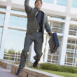 Businessman leaping for joy - Stock Photo