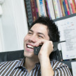 Man talking on telephone - Stock Photo