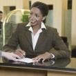 Businesswoman checking into hotel — Stock Photo
