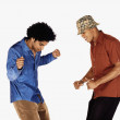 Two young men dancing — Stock Photo