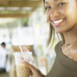 Portrait of young woman with iced drink — Stock Photo
