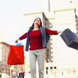 Young woman excited while shopping - Stock Photo