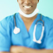 Foto Stock: Portrait of male doctor in scrubs
