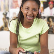 Teenage girl with game controller — Stock Photo
