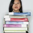 Portrait of businesswoman holding files - Stock Photo