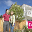 Couple with house for sale — Stock Photo