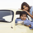 Portrait of couple by car - Stock Photo