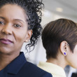 Close-up of a two businesswoman standing with their backs towards each other — Stock Photo