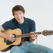 Stock Photo: Young mplaying guitar