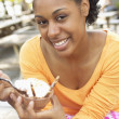Woman eating dessert — Stock Photo
