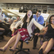 Businesspeople relay racing in office — Stock Photo