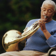 Man playing french horn — Stock Photo