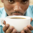Man drinking coffee - Stock Photo