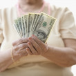 Royalty-Free Stock Photo: Midsection of woman holding cash