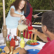 Stock Photo: Family at backyard barbecue