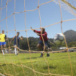 Royalty-Free Stock Photo: Men scoring goal in soccer game