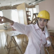 Female architect pointing — Stock Photo