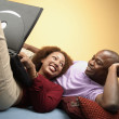 Couple laying on floor with laptop — Stock Photo #23222200