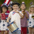Portrait of children in 4th of July parade - Stock Photo