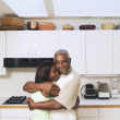 Father and teenage daughter hugging - Stock Photo