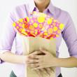 Woman holding gift bag — Stock Photo