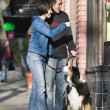 Couple with dog window shopping — Stock Photo