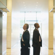 Businessmen waiting for elevator - Stock Photo