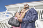 Couple standing on porch — Stock Photo