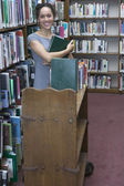 Portrait of librarian holding books — Stock Photo