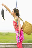 Profile of woman catching fish — Stock Photo