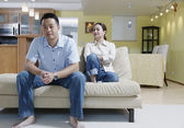 Couple sitting on couch — Stock Photo