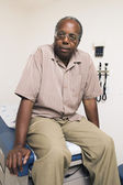 Portrait of male patient in examination room — Stock Photo