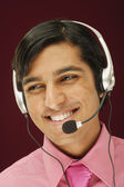 Man talking with headset — Stock Photo