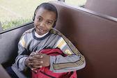 Portrait of boy with headphones on school bus — Stock Photo