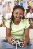 Teenage girl with game controller — Stockfoto