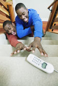 Brothers wrestling to grab phone — Stock Photo