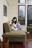 Mother reading book to daughter — Stock Photo