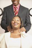 Businessman giving businesswoman massage — Stock Photo