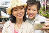 Two women taking self-portrait — Stock Photo