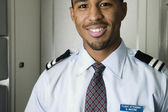 Close up portrait of male flight attendant — Stock Photo