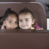 Portrait of girls on school bus — Stock Photo