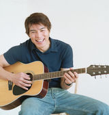 Young man playing a guitar — Stock Photo