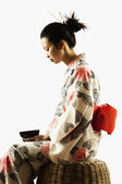 Profile portrait of woman in kimono — Stock Photo
