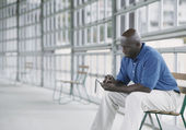 Man dialing cell phone — Stock Photo