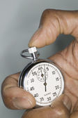 Close up of hand holding stop watch — Stok fotoğraf