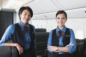 Portrait of two female flight attendants — Stock Photo