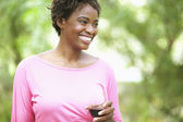 Woman laughing and drinking wine — Stock Photo
