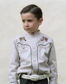 Little boy wearing cowboy shirt — Stock Photo