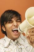 Man shouting through bull horn — Stock Photo