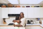 Father and teenage daughter hugging — Stock Photo